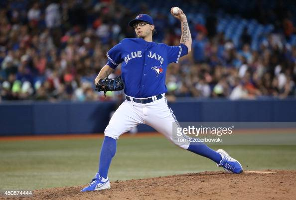 Brett Cecil of the Toronto Blue Jays pitches in the ninth inning during an MLB game against the Minnesota Twins on June 11 2014 at Rogers Centre in...