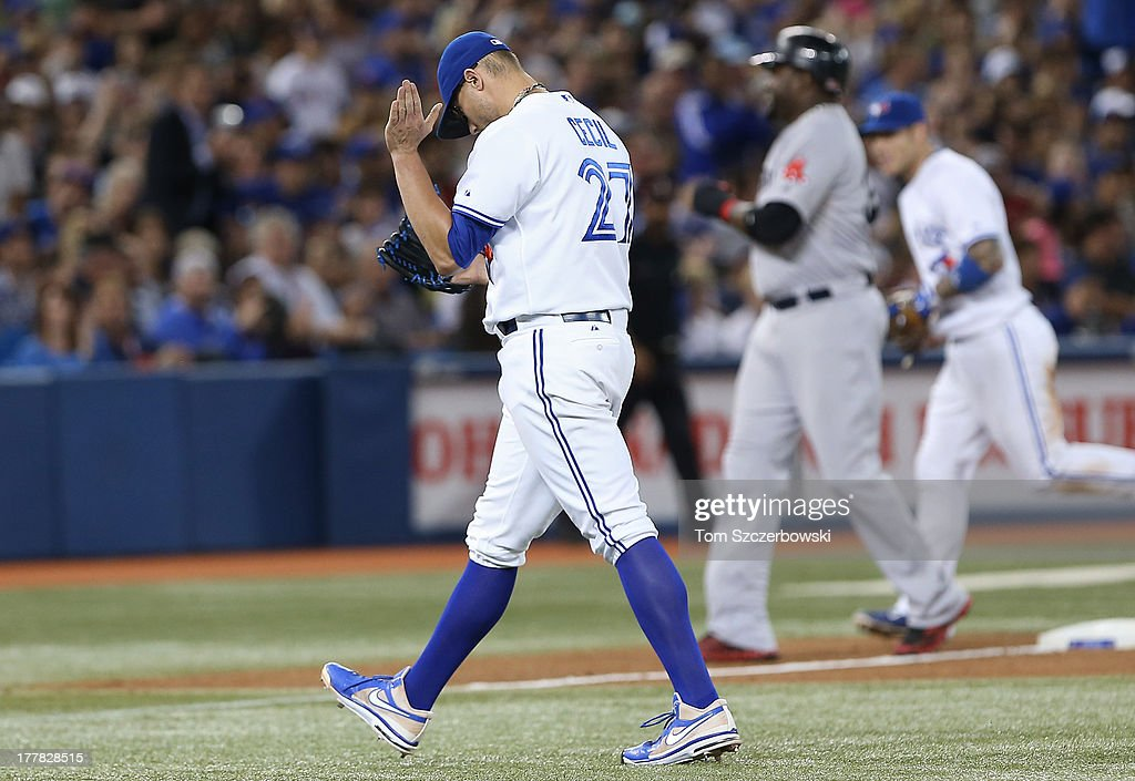 <a gi-track='captionPersonalityLinkClicked' href=/galleries/search?phrase=Brett+Cecil&family=editorial&specificpeople=4556338 ng-click='$event.stopPropagation()'>Brett Cecil</a> #27 of the Toronto Blue Jays reacts after getting the final out of the sixth inning during MLB game action against the Boston Red Sox on August 13, 2013 at Rogers Centre in Toronto, Ontario, Canada.