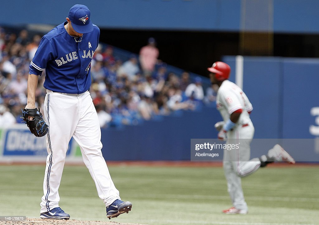 <a gi-track='captionPersonalityLinkClicked' href=/galleries/search?phrase=Brett+Cecil&family=editorial&specificpeople=4556338 ng-click='$event.stopPropagation()'>Brett Cecil</a> #27 of the Toronto Blue Jays reacts to a John Mayberry Jr. #15 of the Philadelphia Phillies home run during MLB action at The Rogers Centre June 17, 2012 in Toronto, Ontario, Canada.