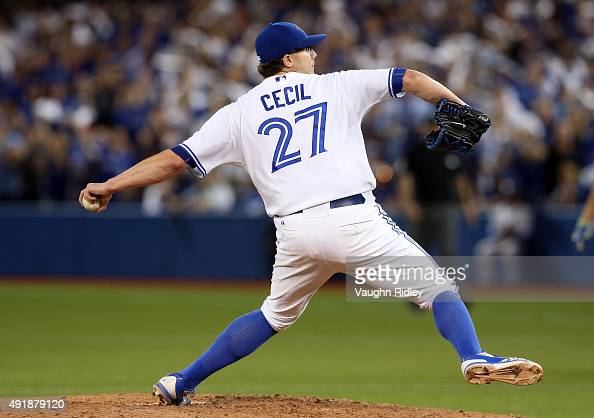 Brett Cecil of the Toronto Blue Jays throws a pitch in the eighth inning against the Texas Rangers during game one of the American League Division...