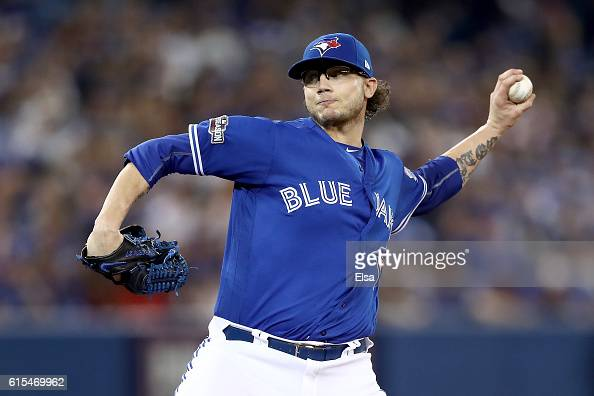Brett Cecil of the Toronto Blue Jays throws a pitch in the seventh inning against the Cleveland Indians during game four of the American League...