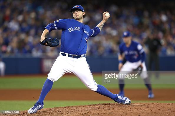 Brett Cecil of the Toronto Blue Jays throws a pitch in the seventh inning against the Cleveland Indians during game five of the American League...