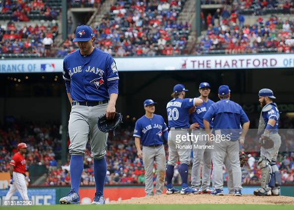 Brett Cecil of the Toronto Blue Jays walks off the field after being taken out of the game against the Texas Rangers in the seventh inning of game...