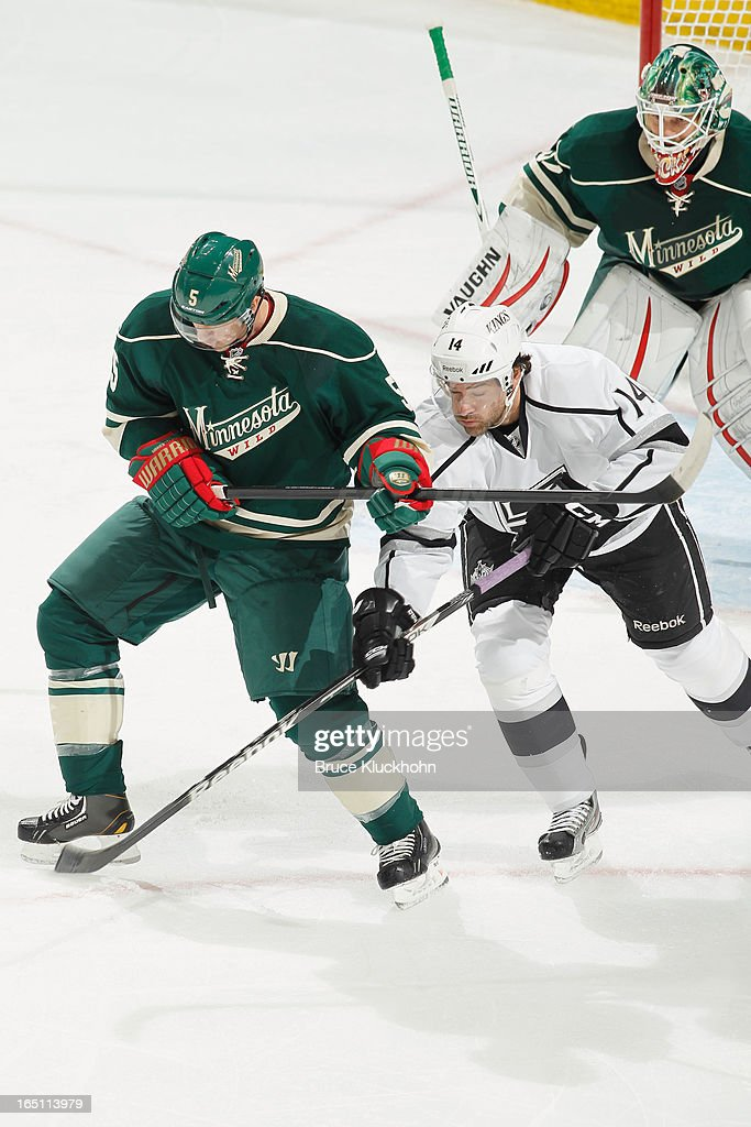 <a gi-track='captionPersonalityLinkClicked' href=/galleries/search?phrase=Brett+Clark&family=editorial&specificpeople=588182 ng-click='$event.stopPropagation()'>Brett Clark</a> #5 of the Minnesota Wild battles for the puck with Justin Williams #14 of the Los Angeles Kings during the game on March 30, 2013 at the Xcel Energy Center in Saint Paul, Minnesota.