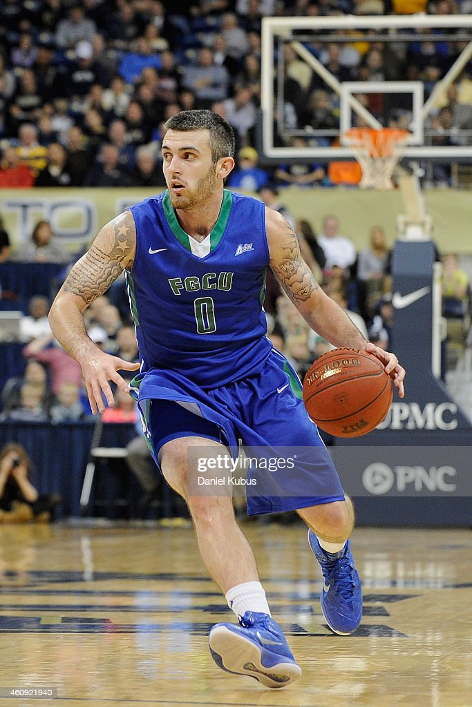 Brett Comer #0 of the Florida Gulf Coast Eagles brings the ball up court against the Pittsburgh Panthers at Petersen Events Center on December 30, 2014 in Pittsburgh, Pennsylvania.
