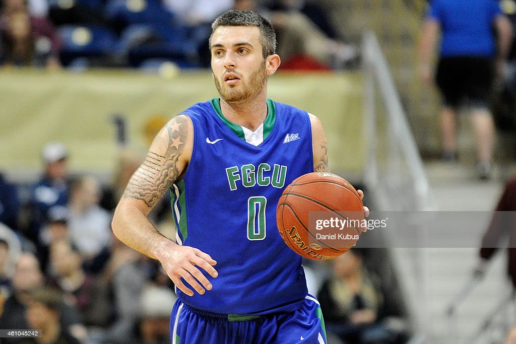 <a gi-track='captionPersonalityLinkClicked' href=/galleries/search?phrase=Brett+Comer&family=editorial&specificpeople=8682645 ng-click='$event.stopPropagation()'>Brett Comer</a> #0 of the Florida Gulf Coast Eagles brings the ball up court against the Pittsburgh Panthers at Petersen Events Center on December 30, 2014 in Pittsburgh, Pennsylvania.