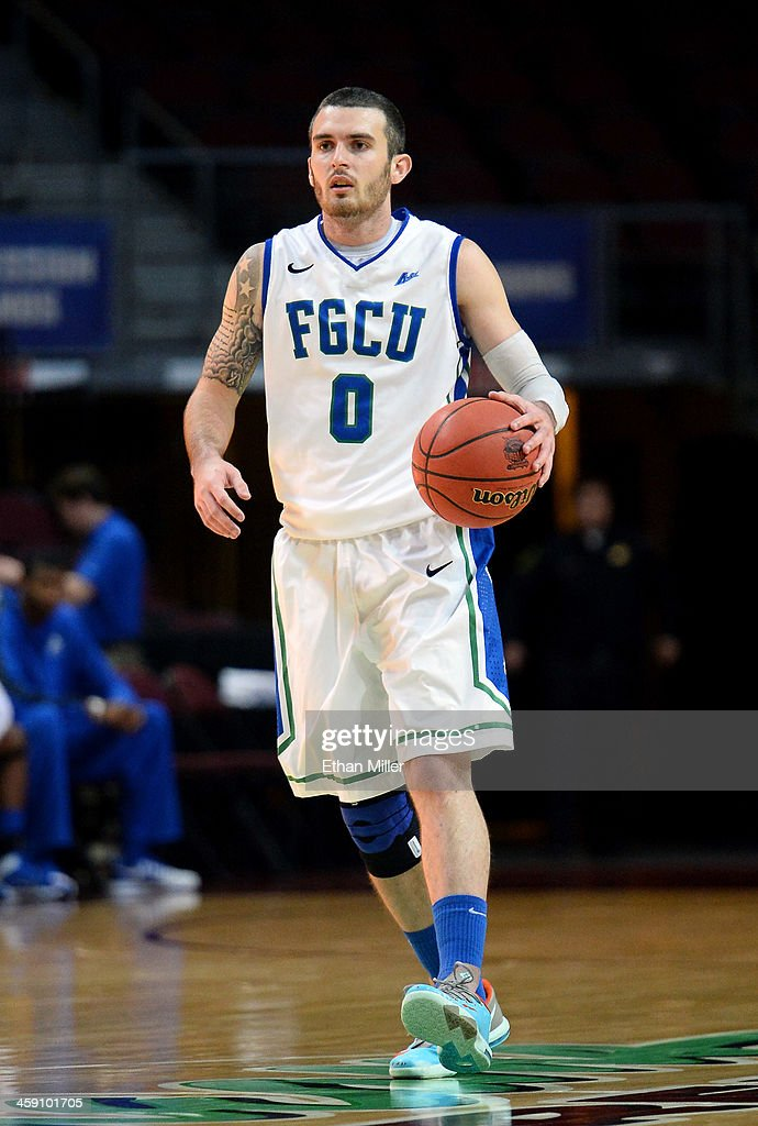 <a gi-track='captionPersonalityLinkClicked' href=/galleries/search?phrase=Brett+Comer&family=editorial&specificpeople=8682645 ng-click='$event.stopPropagation()'>Brett Comer</a> #0 of the Florida Gulf Coast Eagles brings the ball up the court against the Florida A&M Rattlers during the 2013 Continental Tire Las Vegas Classic at the Orleans Arena on December 22, 2013 in Las Vegas, Nevada. Florida Gulf Coast won 77-68.