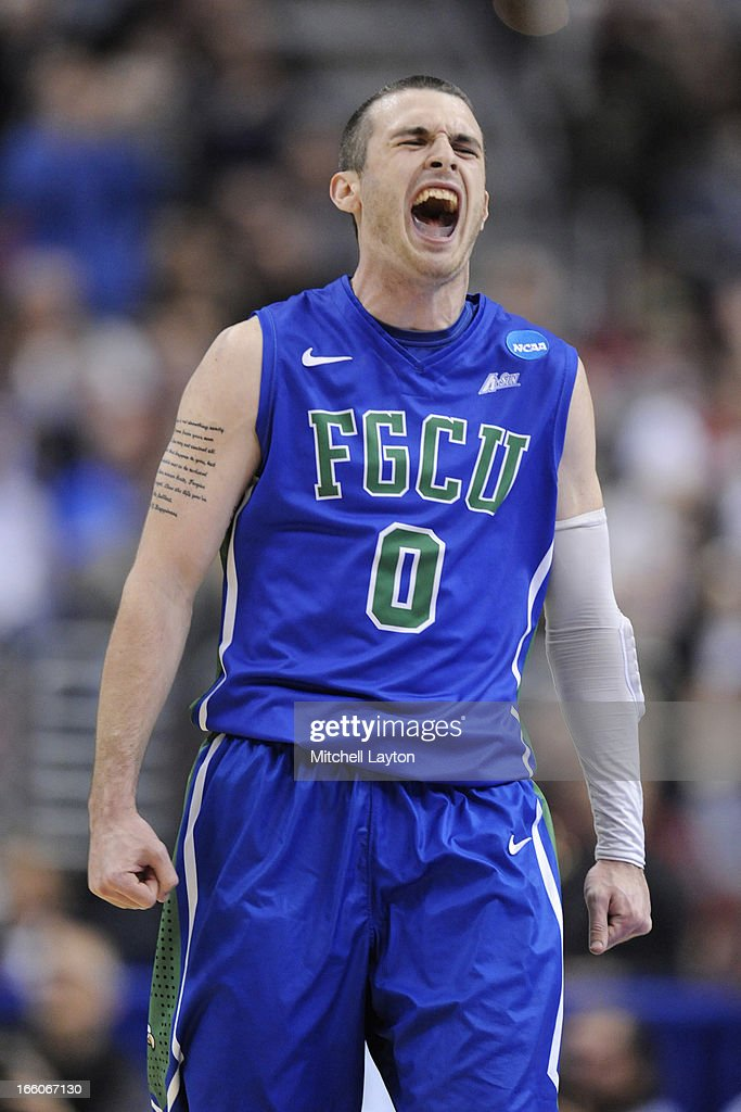 Brett Comer #0 of the Florida Gulf Coast Eagles celebrates a shot during the second round of the 2013 NCAA Men's Basketball Tournament game against the Georgetown Hoyas on March 22, 2013 at Wells Fargo Center in Philadelphia, Pennsylvania. The Eagles won 78-68.