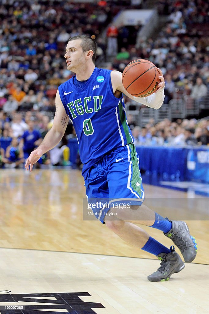 Brett Comer #0 of the Florida Gulf Coast Eagles dribbles the ball during the second round of the 2013 NCAA Men's Basketball Tournament game against the Georgetown Hoyas on March 22, 2013 at Wells Fargo Center in Philadelphia, Pennsylvania. The Eagles won 78-68.