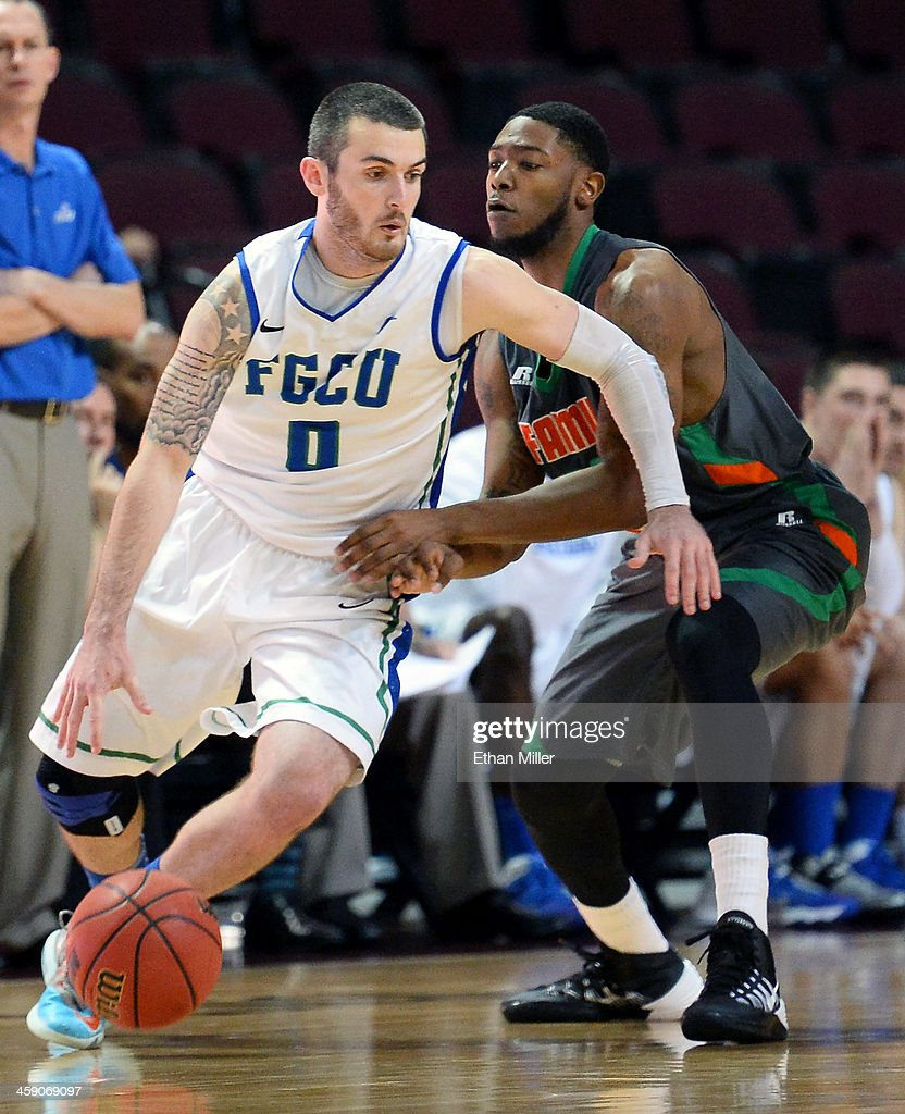 <a gi-track='captionPersonalityLinkClicked' href=/galleries/search?phrase=Brett+Comer&family=editorial&specificpeople=8682645 ng-click='$event.stopPropagation()'>Brett Comer</a> #0 of the Florida Gulf Coast Eagles drives against Jomari Bradshaw #23 of the Florida A&M Rattlers during the 2013 Continental Tire Las Vegas Classic at the Orleans Arena on December 22, 2013 in Las Vegas, Nevada. Florida Gulf Coast won 77-68.