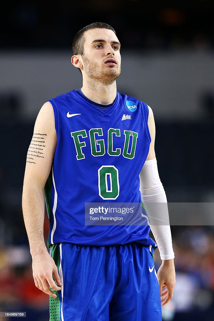Brett Comer #0 of the Florida Gulf Coast Eagles reacts in the second half against the Florida Gators during the South Regional Semifinal round of the 2013 NCAA Men's Basketball Tournament at Dallas Cowboys Stadium on March 29, 2013 in Arlington, Texas.