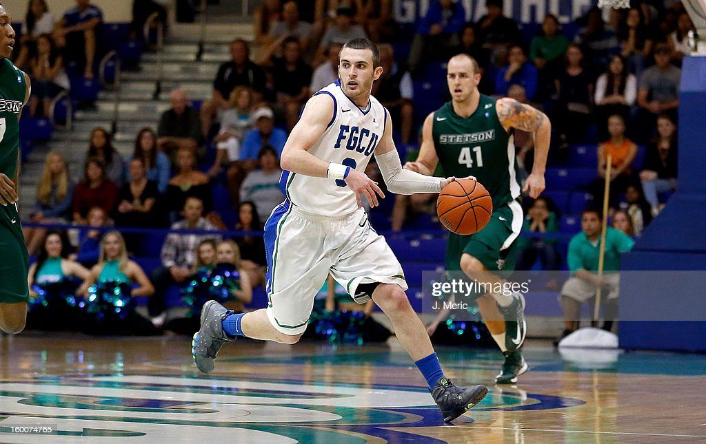 Brett Comer #0 of the Florida Gulf Coast University Eagles brings the ball up the court against the Stetson Hatters during the game at Alico Arena on January 25, 2013 in Ft. Myers, Florida.