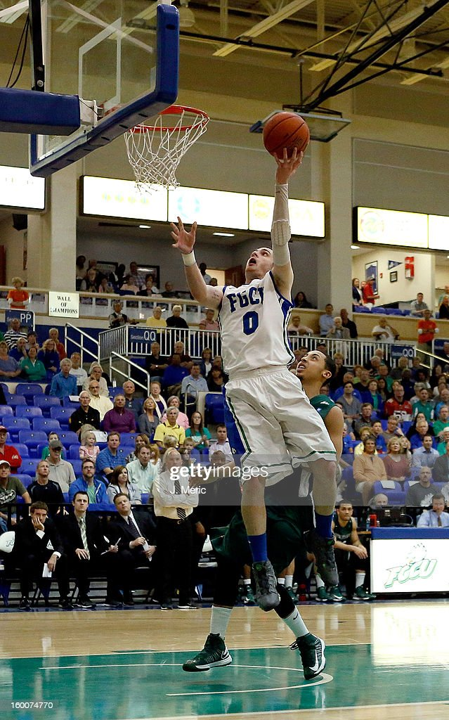 Brett Comer #0 of the Florida Gulf Coast University Eagles drives to the basket as Aaron Graham #11 of the Stetson Hatters defends during the game at Alico Arena on January 25, 2013 in Ft. Myers, Florida.