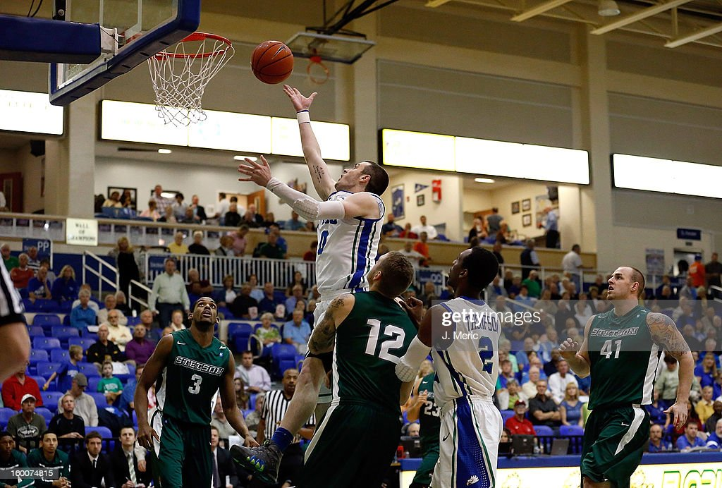 Brett Comer #0 of the Florida Gulf Coast University Eagles lays the ball up against the Stetson Hatters during the game at Alico Arena on January 25, 2013 in Ft. Myers, Florida.