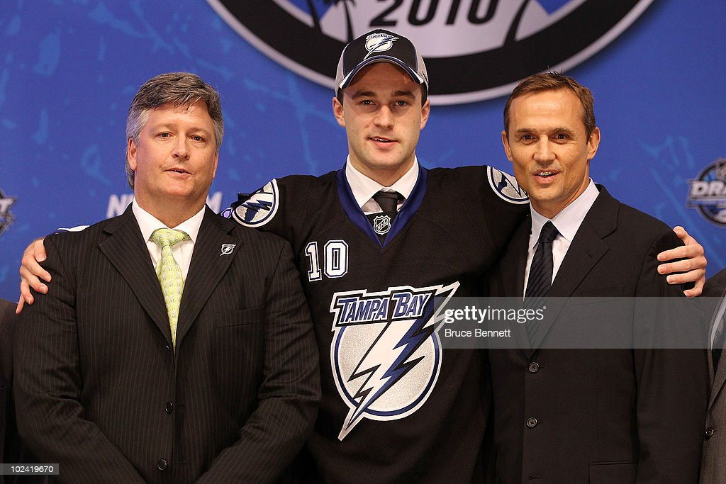 Brett Connolly, drafted sixth overall by the Tampa Bay Lightning, poses on stage with team personnel during the 2010 NHL Entry Draft at Staples Center on June 25, 2010 in Los Angeles, California.