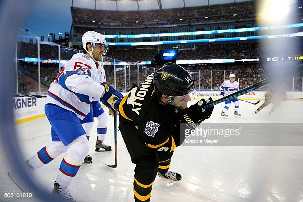 Brett Connolly of the Boston Bruins competes with Max Pacioretty of the Montreal Canadiens in the third period during the 2016 Bridgestone NHL Winter...