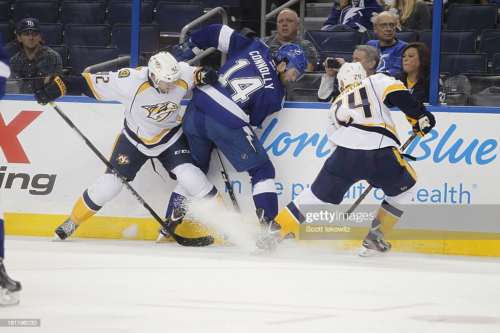 <a gi-track='captionPersonalityLinkClicked' href=/galleries/search?phrase=Brett+Connolly&family=editorial&specificpeople=5870564 ng-click='$event.stopPropagation()'>Brett Connolly</a> #14 of the Tampa Bay Lightning battles for the puck against Mattias Ekholm #42 and <a gi-track='captionPersonalityLinkClicked' href=/galleries/search?phrase=Eric+Nystrom&family=editorial&specificpeople=2209813 ng-click='$event.stopPropagation()'>Eric Nystrom</a> #24 of the Nashville Predators during the first period at Tampa Bay Times Forum on September 19, 2013 in Tampa, Florida.
