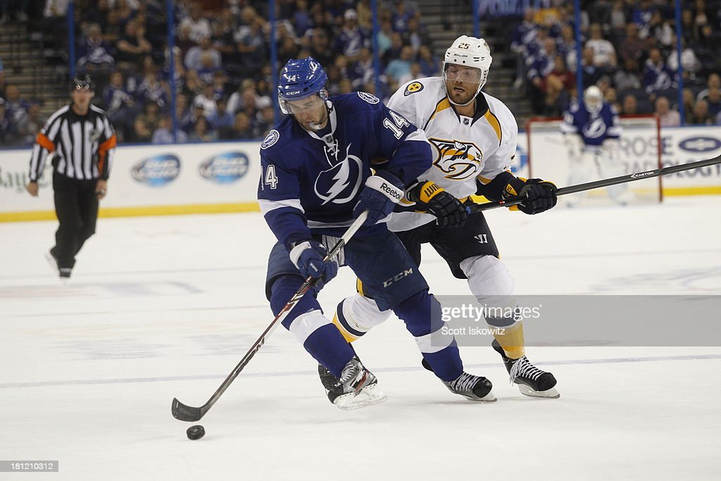 <a gi-track='captionPersonalityLinkClicked' href=/galleries/search?phrase=Brett+Connolly&family=editorial&specificpeople=5870564 ng-click='$event.stopPropagation()'>Brett Connolly</a> #14 of the Tampa Bay Lightning controls the puck against <a gi-track='captionPersonalityLinkClicked' href=/galleries/search?phrase=Viktor+Stalberg&family=editorial&specificpeople=5802237 ng-click='$event.stopPropagation()'>Viktor Stalberg</a> #25 of the Nashville Predators at Tampa Bay Times Forum on September 19, 2013 in Tampa, Florida.