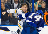 Brett Connolly of the Tampa Bay Lightning fights against Tyson Strachan of the Buffalo Sabres during the third period at the Amalie Arena on December...