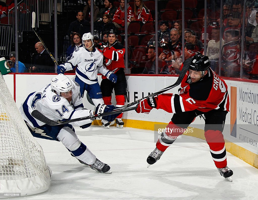 <a gi-track='captionPersonalityLinkClicked' href=/galleries/search?phrase=Brett+Connolly&family=editorial&specificpeople=5870564 ng-click='$event.stopPropagation()'>Brett Connolly</a> #14 of the Tampa Bay Lightning gets the stick up on <a gi-track='captionPersonalityLinkClicked' href=/galleries/search?phrase=Andy+Greene&family=editorial&specificpeople=3568726 ng-click='$event.stopPropagation()'>Andy Greene</a> #6 of the New Jersey Devils at the Prudential Center on December 19, 2014 in Newark, New Jersey. The Devils defeated the Lightning 3-2 in the shootout.