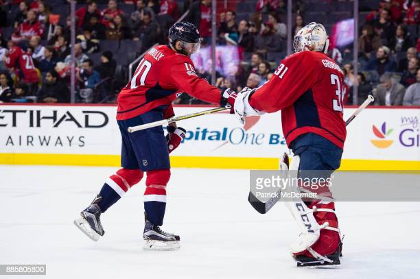 Brett Connolly of the Washington Capitals celebrates with Philipp Grubauer after scoring a second period goal against the San Jose Sharks at Capital...