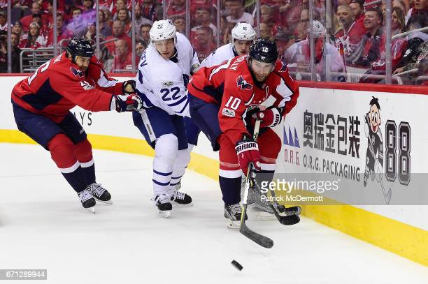 Brett Connolly of the Washington Capitals controls the puck against Mitch Marner and Nikita Zaitsev of the Toronto Maple Leafs during the first...