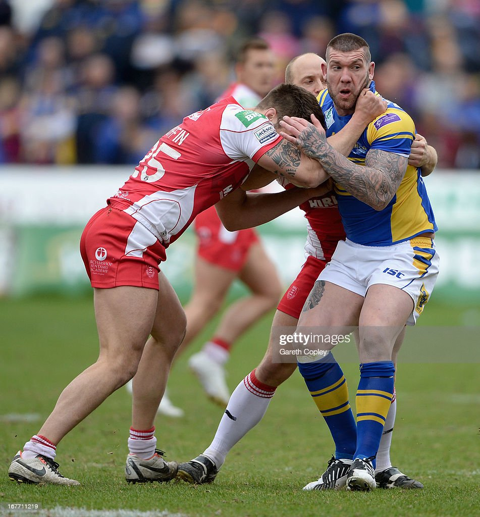 Brett Delaney of Leeds is tackled by George Griffin of Hull KR during the Super League match between Hull Kingston Rovers and Leeds Rhinos at Craven Park Stadium on April 28, 2013 in Hull, England.