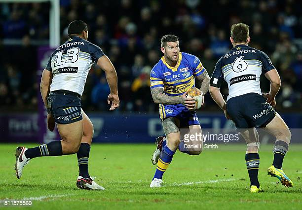 Brett Delaney of Leeds Rhinos faces Michael Morgan of North Queensland Cowboys during the World Club Series match between Leeds Rhinos and North...