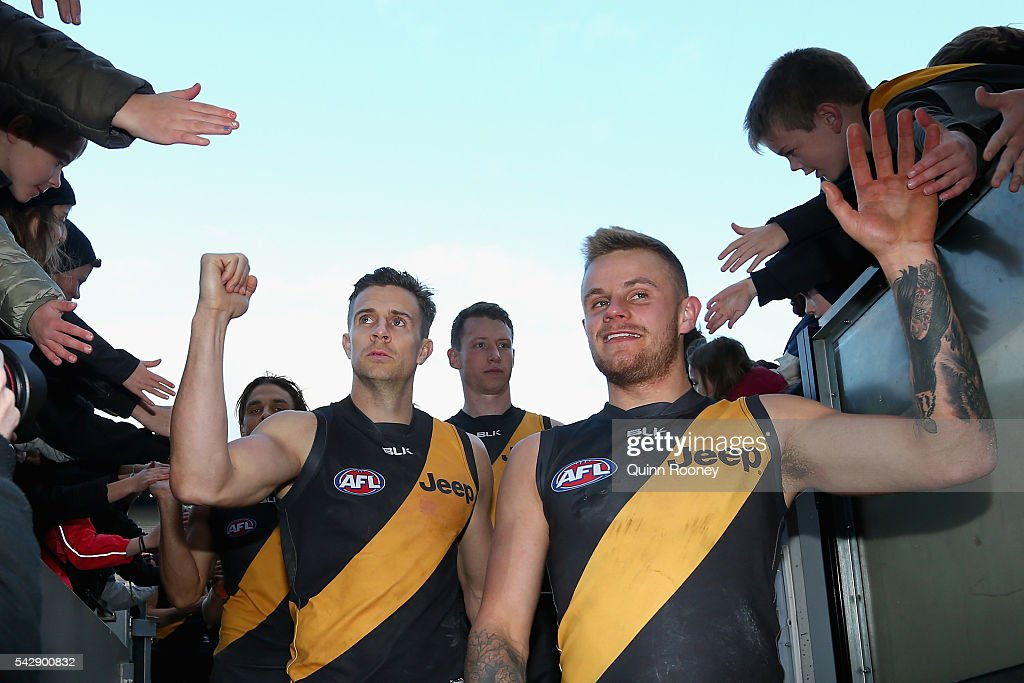 <a gi-track='captionPersonalityLinkClicked' href=/galleries/search?phrase=Brett+Deledio&family=editorial&specificpeople=524933 ng-click='$event.stopPropagation()'>Brett Deledio</a> and Brandon Ellis of the Tigers celebrate winning the round 14 AFL match between the Richmond Tigers and the Brisbane Lions at Melbourne Cricket Ground on June 25, 2016 in Melbourne, Australia.