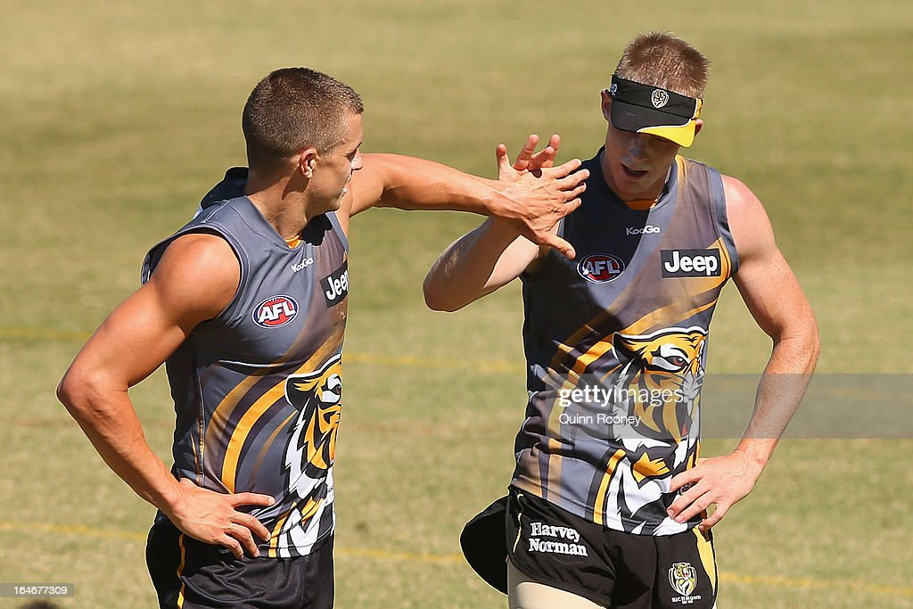 <a gi-track='captionPersonalityLinkClicked' href=/galleries/search?phrase=Brett+Deledio&family=editorial&specificpeople=524933 ng-click='$event.stopPropagation()'>Brett Deledio</a> and <a gi-track='captionPersonalityLinkClicked' href=/galleries/search?phrase=Jack+Riewoldt&family=editorial&specificpeople=2327975 ng-click='$event.stopPropagation()'>Jack Riewoldt</a> of the Tigers high five during a Richmond Tigers AFL training session at ME Bank Centre on March 26, 2013 in Melbourne, Australia.
