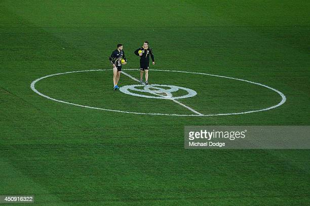 Brett Deledio and Nathan Foley of the Tigers inspect the centre circle during the round 14 AFL match between the Richmond Tigers and the Sydney Swans...