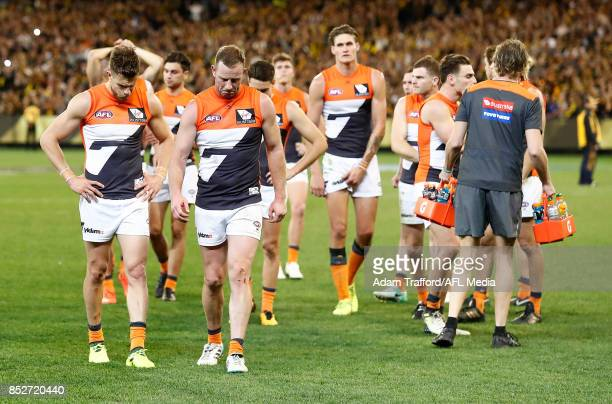 Brett Deledio and Steve Johnson of the Giants look dejected after a loss during the 2017 AFL Second Preliminary Final match between the Richmond...