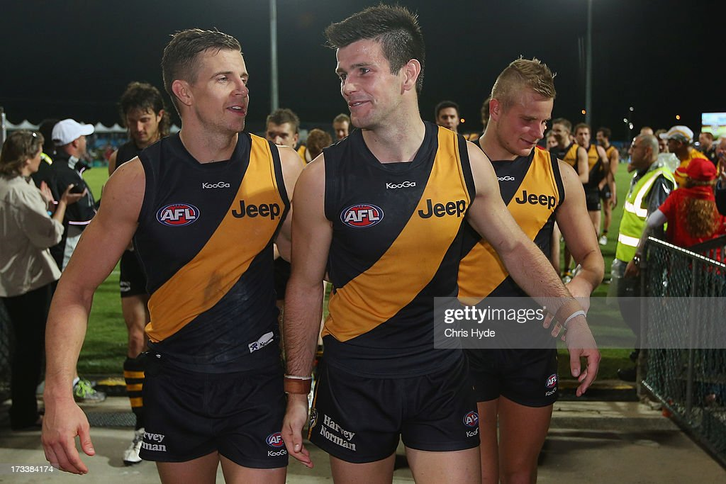 <a gi-track='captionPersonalityLinkClicked' href=/galleries/search?phrase=Brett+Deledio&family=editorial&specificpeople=524933 ng-click='$event.stopPropagation()'>Brett Deledio</a> and Trent Cotchin of the Tigers leave the field after winning the round 16 AFL match between the Richmond Tigers and the Gold Coast Suns at Cazaly's Stadium on July 13, 2013 in Cairns, Australia.