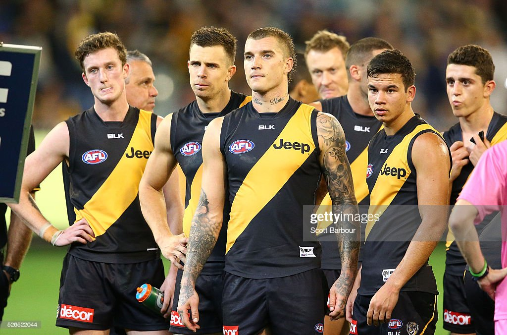 Brett Deledio, Dustin Martin and Daniel Rioli of the Tigers look on at three quarter time during the round six AFL match between the Richmond Tigers and the Port Adelaide Power at Melbourne Cricket Ground on April 30, 2016 in Melbourne, Australia.