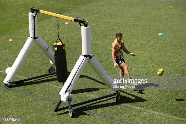 Brett Deledio kicks the ball next to a boxing bag contraption used to bump into players during a Richmond Tigers AFL training session at ME Bank...