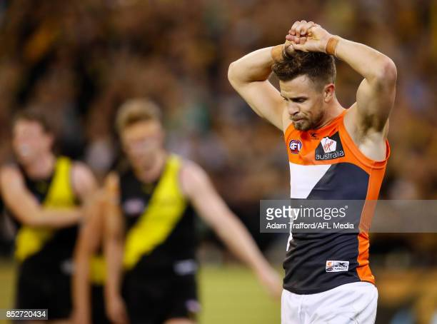 Brett Deledio of the Giants looks dejected after a loss in his 250th game against his former side to go through to the grand final during the 2017...
