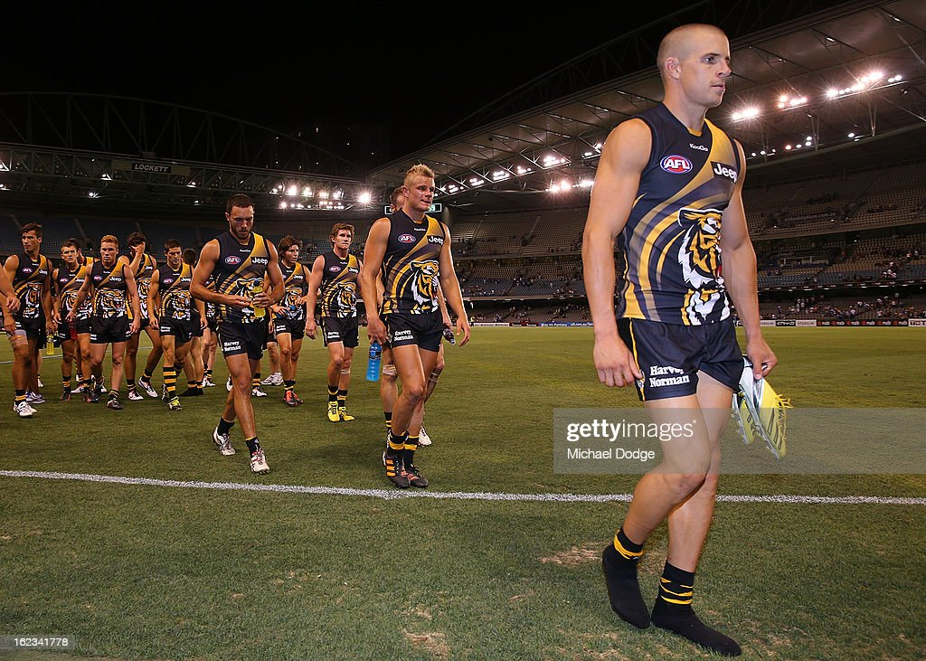 <a gi-track='captionPersonalityLinkClicked' href=/galleries/search?phrase=Brett+Deledio&family=editorial&specificpeople=524933 ng-click='$event.stopPropagation()'>Brett Deledio</a> of the Richmond Tigers leads the team off after their loss during the round one AFL NAB Cup match between the Richmond Tigers and the North Melbourne Kangaroos at Etihad Stadium on February 22, 2013 in Melbourne, Australia.