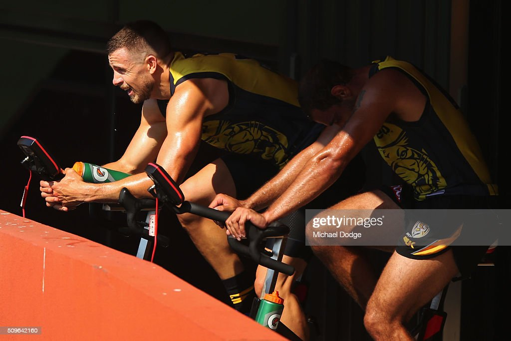 <a gi-track='captionPersonalityLinkClicked' href=/galleries/search?phrase=Brett+Deledio&family=editorial&specificpeople=524933 ng-click='$event.stopPropagation()'>Brett Deledio</a> of the Tigers (L) and Chris Yarran of the Tigers ride an exercise bike during the Richmond Tigers AFL intra-club match at Punt Road Oval on February 12, 2016 in Melbourne, Australia.