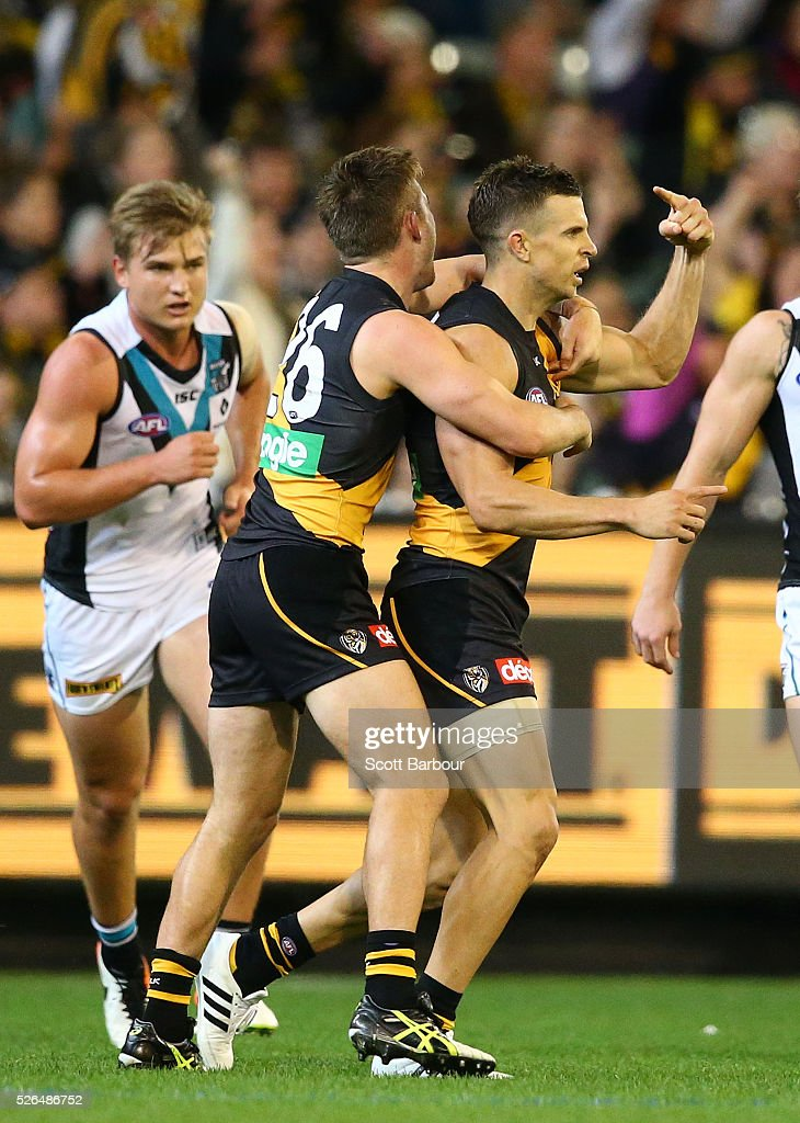 <a gi-track='captionPersonalityLinkClicked' href=/galleries/search?phrase=Brett+Deledio&family=editorial&specificpeople=524933 ng-click='$event.stopPropagation()'>Brett Deledio</a> of the Tigers celebrates after kicking a goal during the round six AFL match between the Richmond Tigers and the Port Adelaide Power at Melbourne Cricket Ground on April 30, 2016 in Melbourne, Australia.