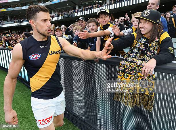 Brett Deledio of the Tigers celebrates the win with fans during the round 21 AFL match between the Collingwood Magpies and the Richmond Tigers at...
