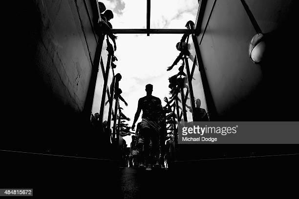 Brett Deledio of the Tigers leads the team off after the warm up during the round 21 AFL match between the Collingwood Magpies and the Richmond...