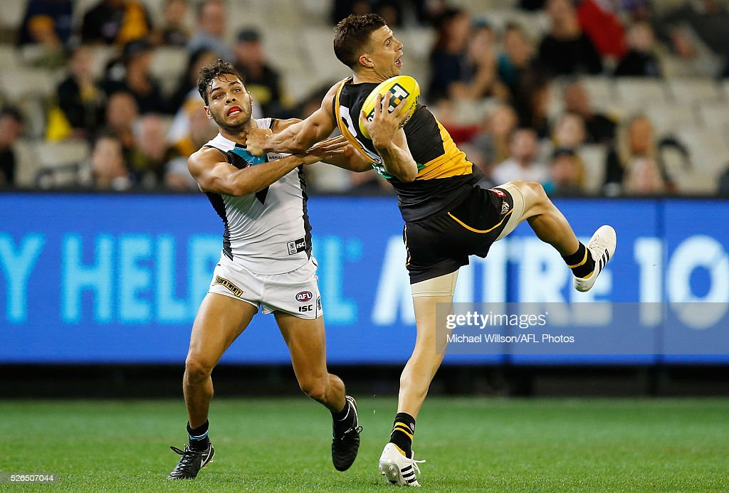 Brett Deledio of the Tigers marks over Jarman Impey of the Power during the 2016 AFL Round 06 match between the Richmond Tigers and Port Adelaide Power at the Melbourne Cricket Ground on April 30, 2016 in Melbourne, Australia.