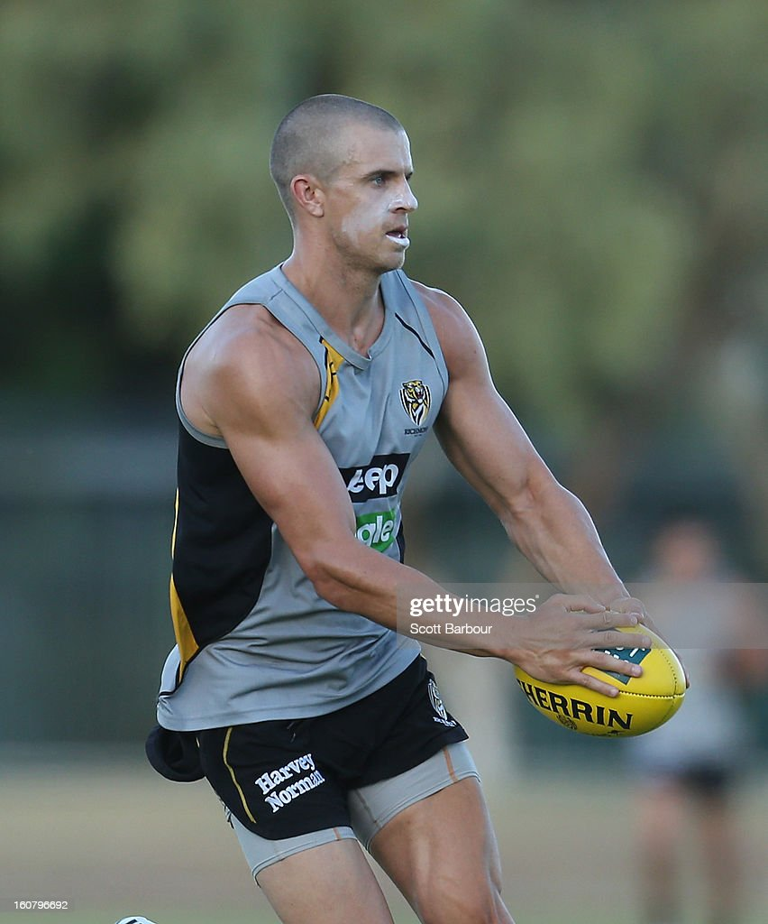 <a gi-track='captionPersonalityLinkClicked' href=/galleries/search?phrase=Brett+Deledio&family=editorial&specificpeople=524933 ng-click='$event.stopPropagation()'>Brett Deledio</a> of the Tigers runs with the ball during a Richmond Tigers AFL training session ahead of the AFL exhibition match between the Richmond Tigers and the Indigenous All Stars at Traeger Park on February 6, 2013 in Alice Springs, Australia.