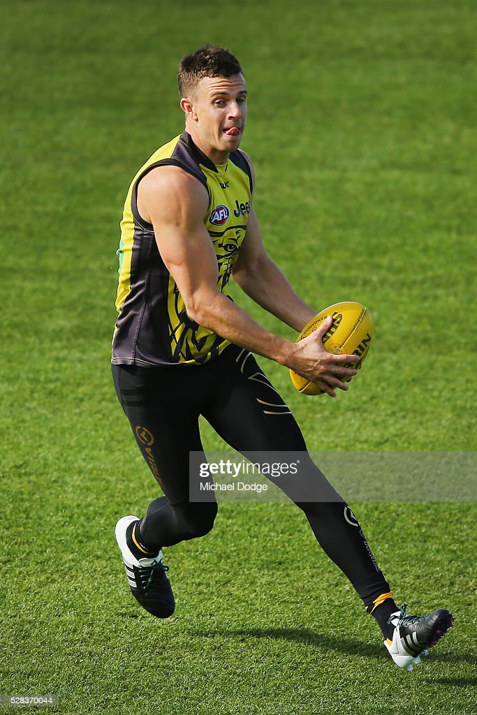 <a gi-track='captionPersonalityLinkClicked' href=/galleries/search?phrase=Brett+Deledio&family=editorial&specificpeople=524933 ng-click='$event.stopPropagation()'>Brett Deledio</a> of the Tigers runs with the ball during a Richmond Tigers AFL training session at Punt Road Oval on May 5, 2016 in Melbourne, Australia.