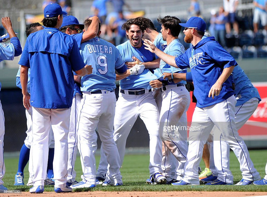 Brett Eibner #12 of the Kansas City Royals celebrates his game-winning RBI single with teammates in the ninth inning against the Chicago White Sox at Kauffman Stadium on May 28, 2016 in Kansas City, Missouri. The Royals won 8-7.