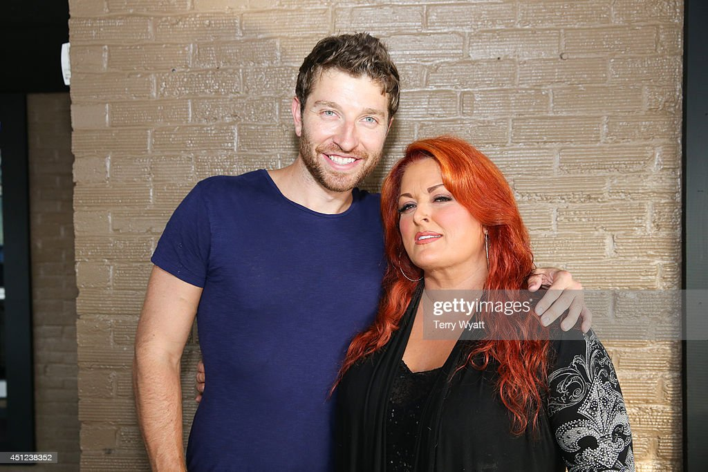 Brett Eldredge and Wynonna Judd attend the ACM Lifting Lives Music Camp Karaoke Night With Brett Eldredge And Wynonna at Winner's Bar on June 25 2014...