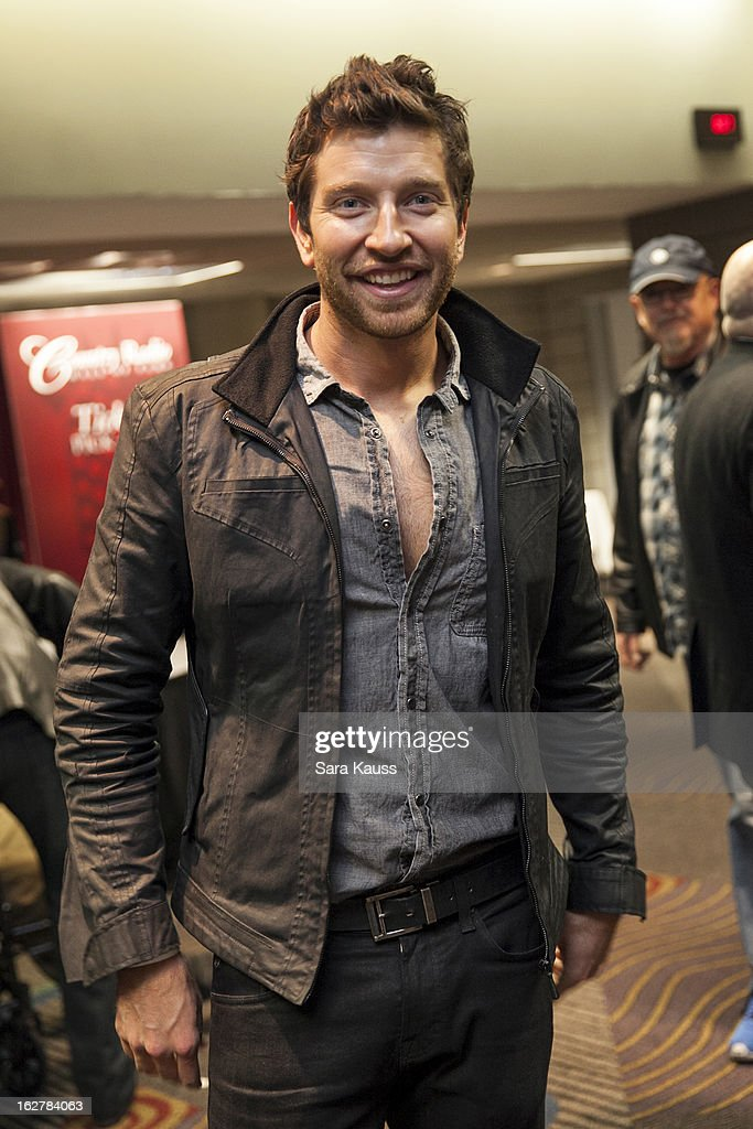 <a gi-track='captionPersonalityLinkClicked' href=/galleries/search?phrase=Brett+Eldredge&family=editorial&specificpeople=7334271 ng-click='$event.stopPropagation()'>Brett Eldredge</a> attends the Country Radio Hall Of Fame cocktail party during CRS 2013 at the Nashville Convention Center on February 26, 2013 in Nashville, Tennessee.