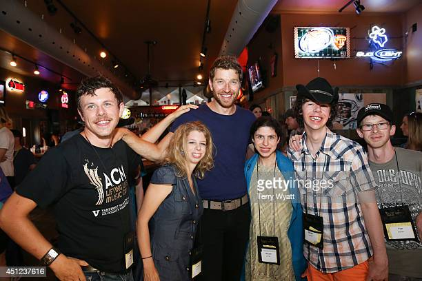 Brett Eldredge enjoys karaoke with campers during the ACM Lifting Lives Music Camp Karaoke Night With Brett Eldredge And Wynonna at Winner's Bar on...