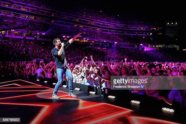 Brett Eldredge performs in front of thousands of fans at the CMA Fest at Nissan Stadium on June 12 2016 in Nashville Tennessee