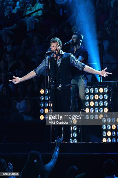 Brett Eldredge performs onstage during the 2014 CMT Music awards at the Bridgestone Arena on June 4 2014 in Nashville Tennessee